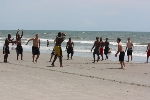 football team at beach