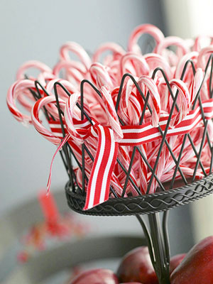 Decorating on a dime - frugal holiday decor in minutes. Tons of great ideas such as use candy canes or ornaments in a bowl.