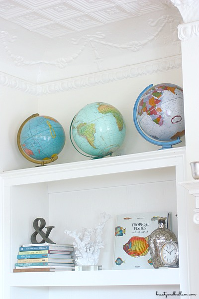 I love the pops of color from these globes against the white walls