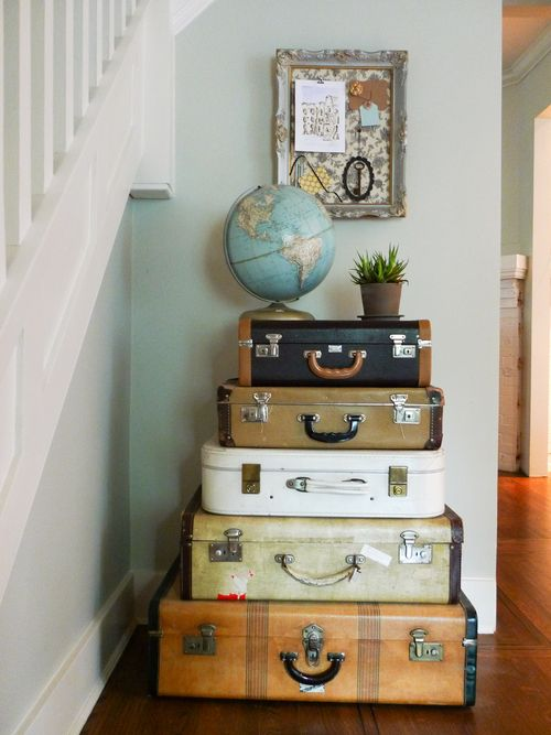 Love stacking suitcases and globes for entry way