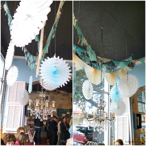 Gorgeous paper garlands decorating bakery