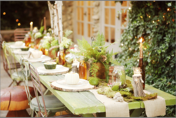 Gorgeous rustic tablescape featuring burlap runners and stump chargers