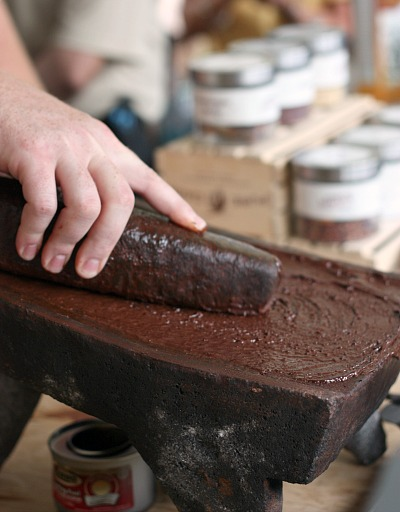 with heat and pressure cocoa beans become melted chocolate