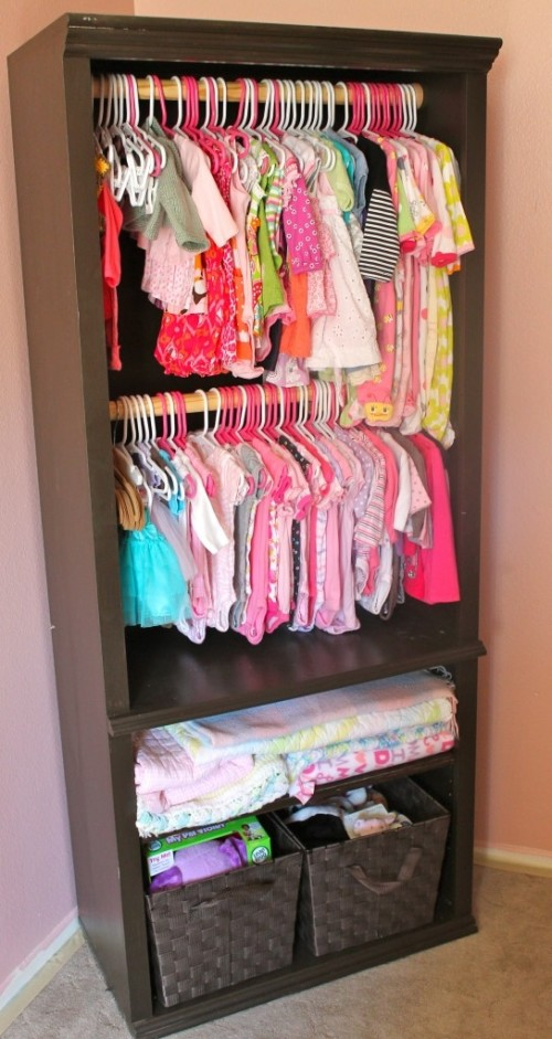 Great use of bookshelves for extra clothes