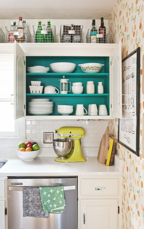 Utilize bins on top of cabinets for storage