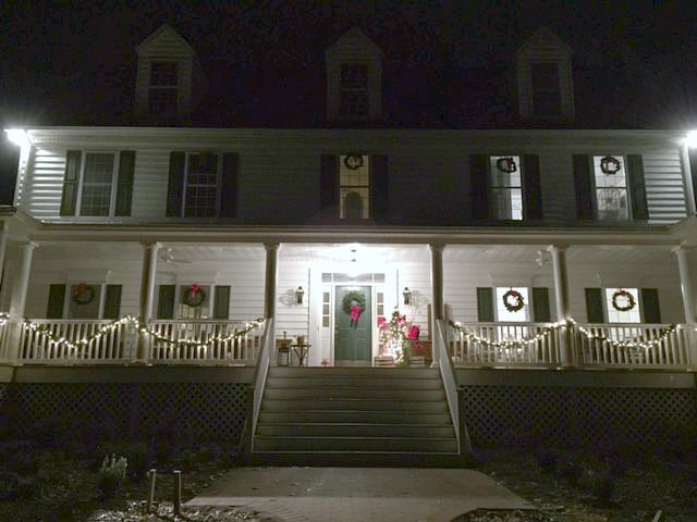 Adding garland to our front porch