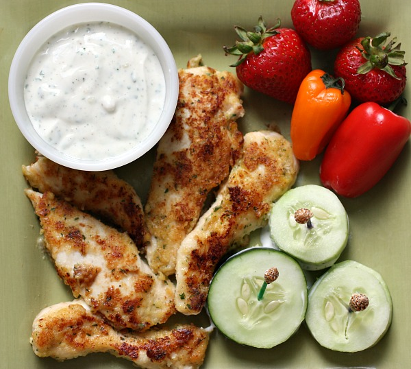 These Parmesan Ranch Chicken Tenders dipped in this delicious Greek Yogurt Ranch is such a healthy snack.