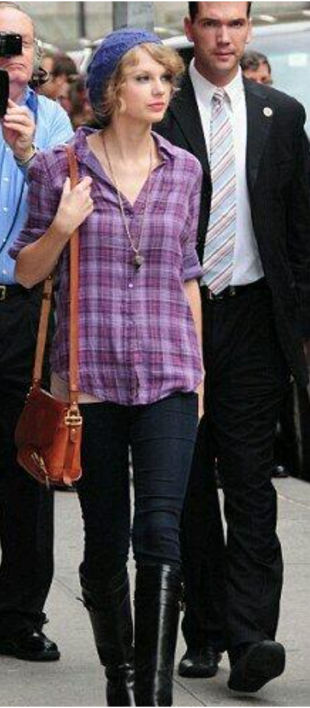Taylor Swift wearing plaid shirt with long boots