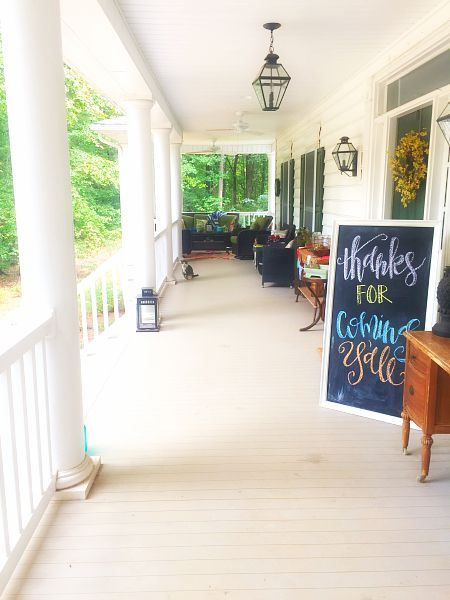 Use large homemade chalkboard on front porch